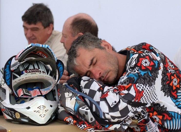 France's Francis Gadioux sleeps during the breakfast before the Stage 5 of the Dakar 2013 between Nazca and Arequipa, Peru, on January 9, 2013. (Franck Fife/Getty Images)