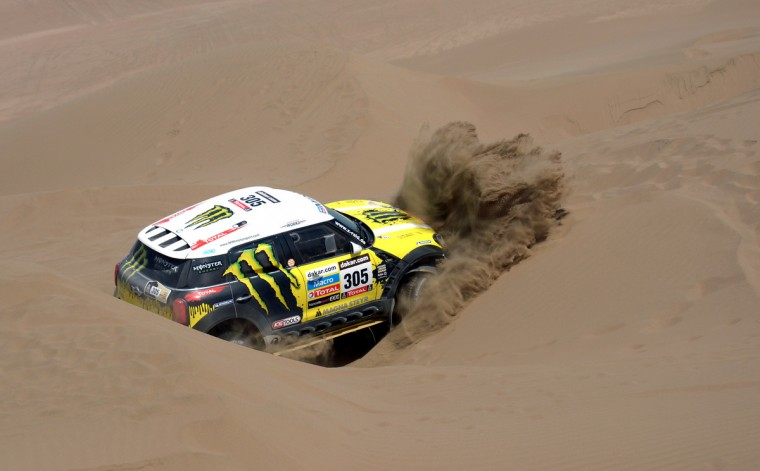Mini's driver Nani Joan Roma of Spain is stuck in the sand during the Stage 6 of the Dakar 2013 between Arica and Calama, Chile. The rally takes place in Peru, Argentina and Chile from January 5 to 20. A(Franck Fife/Getty Images)