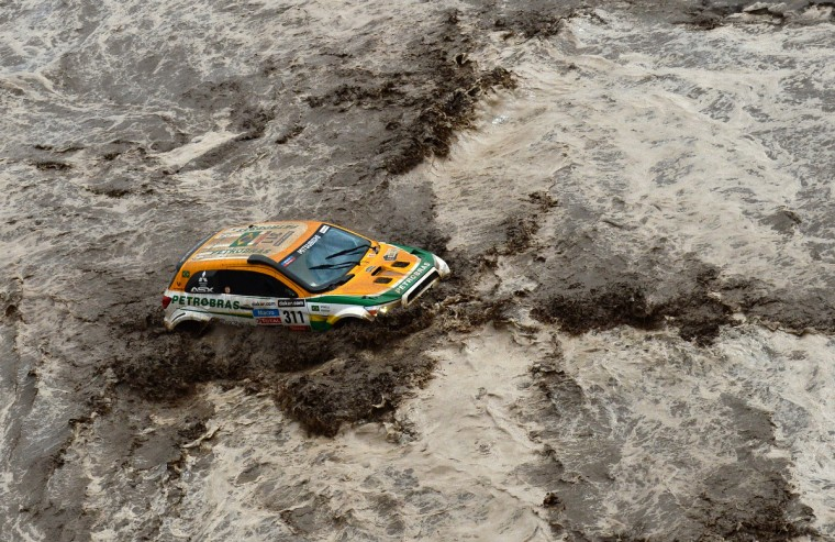 Brazil's Guilherme Spinelli is seen stuck in a flooded river during Stage 8 of the Dakar Rally 2013 between Salta and Tucuman, Argentina, on January 12, 2013. The rally takes place in Peru, Argentina and Chile from January 5-20. (Franck Fife/Getty Images)