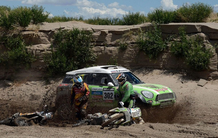 Mini driver Stephane Perterhansel of France passes by Argentina´s Martin Amengual (L) and Spain's Paco Martinez (R) during Stage 8 of the Dakar Rally 2013 between Salta and Tucuman, Argentina, on January 12, 2013. (Franck Fife/Getty Images)