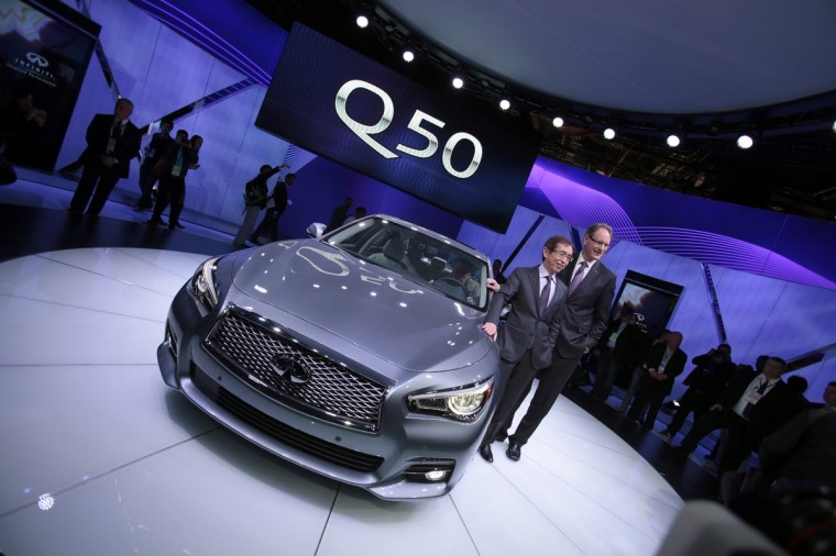 Shiro Nakamura (L), Chief Executive Officer for Infiniti, and Johan Nysschen, President of Infiniti, pose with the new Infinity Q50 luxury sports car at the 2013 North American International Auto Show in Detroit, Michigan. (Geoff Robins Geoff/Getty Images)