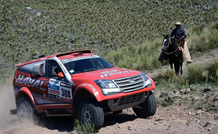 A man on a horse looks at Portuguese Great Wall driver Carlos Sousa during the Stage 9 of the Dakar 2013 between Tucuman and Cordoba, Argentina, on January 14, 2013. (Franck Fife/Getty Images)
