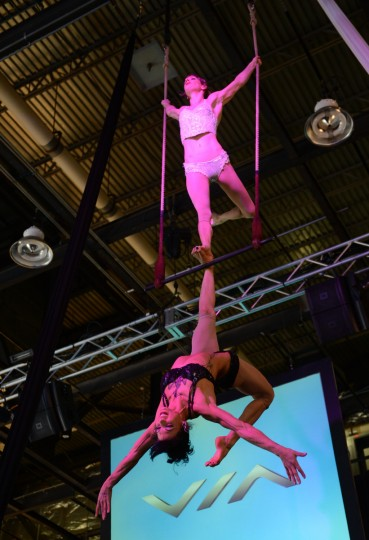 Trapeze artists Duo perform at the Via Motors press conference at the 2013 North American International Auto Show in Detroit, Michigan.(Stan Honda/Getty Images)