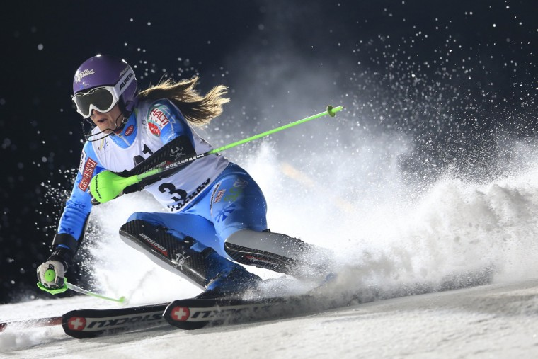 Slovenia's Tina Maze competes during first round of the women's night slalom ski race as part of the 2013 FIS Ski World Cup, in Flachau. (Alexander Klein/Getty Images)