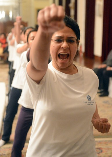 Female staff from the Imperial Hotel perform moves during a self-defence class led by Delhi Police in New Delhi. After One-month of lurid reporting on a horrifying gang-rape and murder of a student in New Delhi, women in the Indian capital say they are more anxious than ever, leading to a surge in interest in self-defence classes.(Raveen Dran/Getty Images)