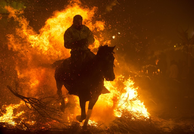 A horseman jumps over a bonfire in the central Spanish village of San Bartolome de Pinares to open the celebrations for the feast of Saint Anthony, patron saint of animals. (Pierre-Philippe Marcou/Gety Images)