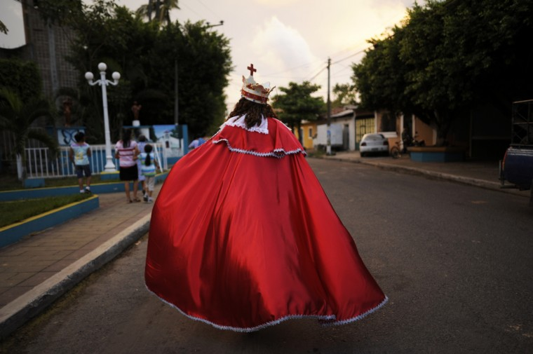 Members of the brotherhood of Saint Sebatian Matyr participate in the dance of The Moors and Christians in the town of Apastepeque, 50 kms east from San Salvador, El Salvador . The members of the Saint Sebastian brotherhood dance in the honor of the co-patron saint of Apatepeque. (Jose Cabezas/Getty Images)