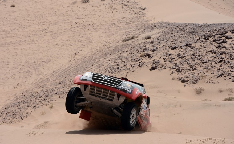 Portugal's Carlos Souza steers Great Wall during the Stage 12 of the 2013 Dakar Rally between Fiambala in Argentina and Copiapo in Chile, on January 17, 2013. (Franck Fife/Getty Images)