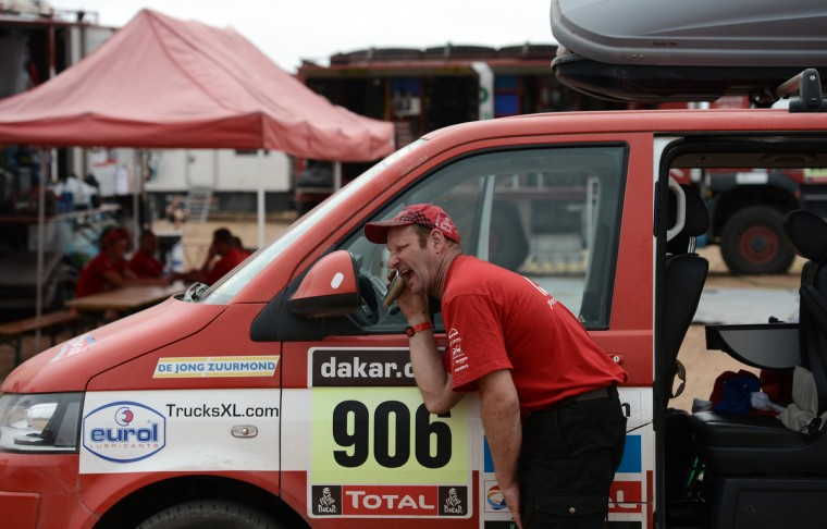 A mechanic shaves at the bivouac, during the Stage 13 of the Rally Dakar 2013 between Copiapo and La Serena, Chile, on January 18, 2013. (Franck Fife/Getty Images)