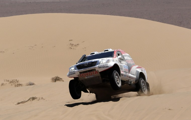 Toyota's driver Giniel De Villiers of South Africa and co-driver Dirk Von Zitzewitz of Germany compete during the Stage 13 of the 2013 Dakar Rally between Copiapo and La Serena, in Chile, on January 18, 2013. The rally is taking place in Peru, Argentina and Chile from January 5 to 20. (Jacky Naegelen/Getty Images)