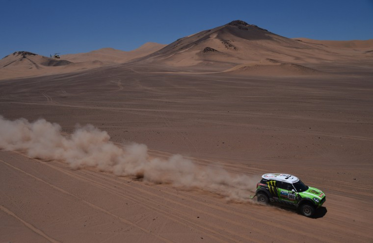 Mini's driver Stephane Perterhansel and co-driver Jean Paul Cottret, both of France, compete in the Stage 13 of the 2013 Dakar Rally between Copiapo and La Serena, in Chile, on January 18, 2013. The rally is taking place in Peru, Argentina and Chile from January 5 to 20. (Getty Images)