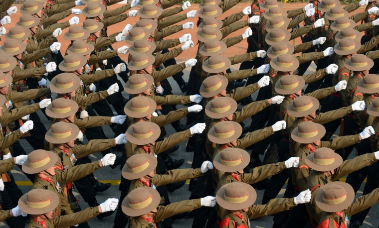 Indian soldiers march down Rajpath during the final full dress rehearsal for the Indian Republic Day parade in New Delhi on January 23, 2013. India will celebrate the 64th Republic Day with a large military parade. (New Delhi/Getty Images)