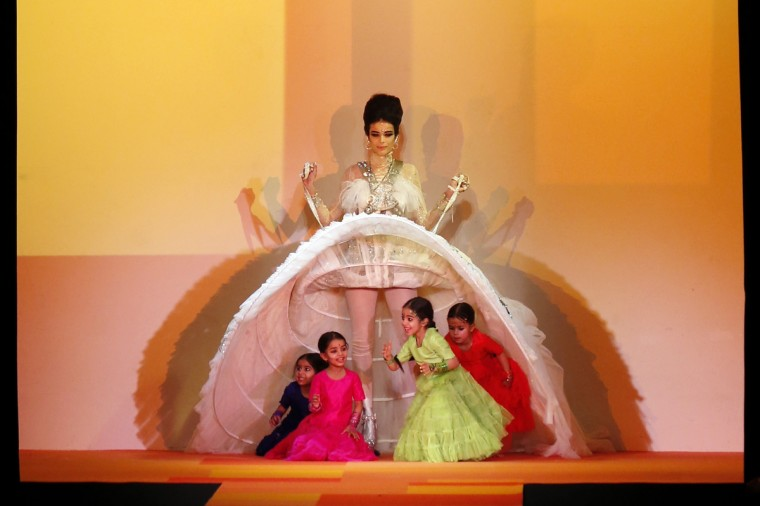 A model presents a creation by French designer Jean Paul Gaultier during the Haute Couture Spring-Summer 2013 collection shows in Paris. (Pierre Verdy/Getty Images)