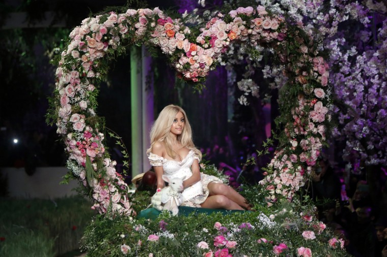 French designer Zahia Dehar arrives on a horse cart at the end of her show on the sidelines of the Haute Couture Spring-Summer 2013 collection presentations in Paris. (Pierre Verdy/Getty Images)