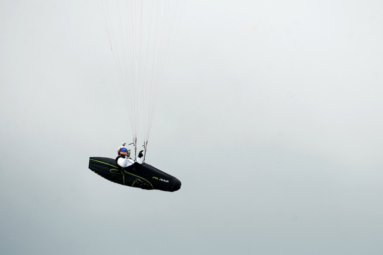 Austrian paraglider pilot Herman Stockl is seen flying in the mountains in Roldanillo, Valle del Cauca department, Colombia, during the Paragliding World Cup Superfina. (Luis Robayo/Getty Images)