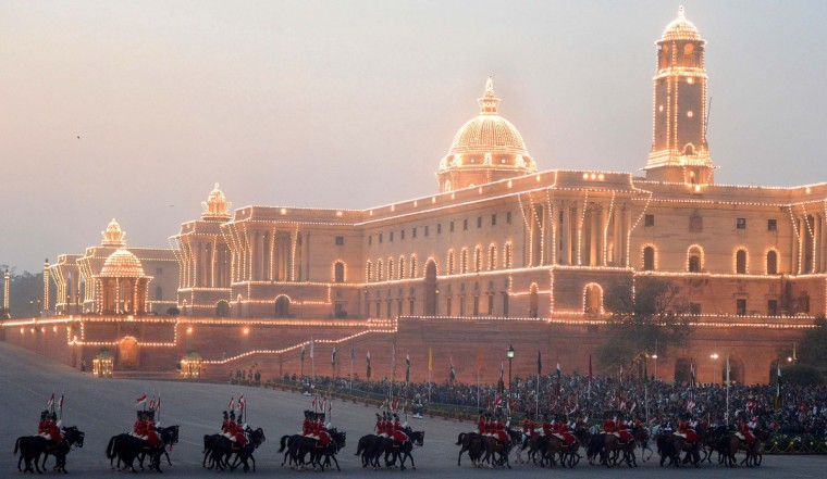 The Central Secretariat and Parliament buildings are illuminated during the Beating Retreat Ceremony at Vijay Chowk in New Delhi. The ceremony is a culmination of Republic Day celebrations and dates back to the days when troops disengaged themselves from battle at sunset. (Raveendran/Getty Images)