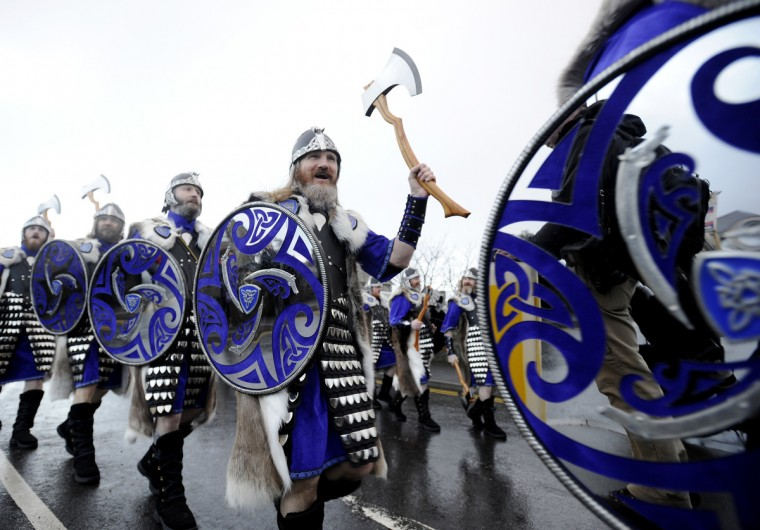 Participants dressed as Vikings march past during the annual Up Helly Aa festival in Lerwick, Shetland Islands. Up Helly Aa celebrates the influence of the Scandinavian Vikings in the Shetland Islands and culminates with up to 1,000 'guizers' (men in costume) throwing flaming torches into their Viking longboat and setting it alight later in the evening. (Andy Buchanan/Getty Images)