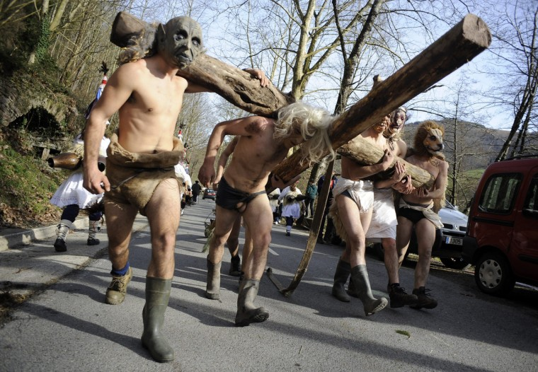 Masked men hold a cross during the carnival of Zubieta, in the northern Spanish province of Navarra province. (Rafa Rivas/Getty Images)