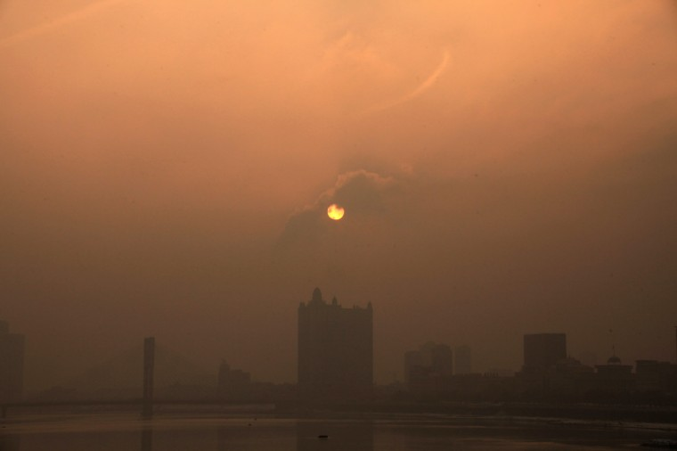 Buildings are shrouded in the heavy smog in Jilin, northeast China's Jilin province. Beijing urged residents to stay indoors on January 30 as emergency measures were rolled out aimed at countering a heavy cloud of smog blanketing the Chinese capital and swathes of the country. (Getty Images)