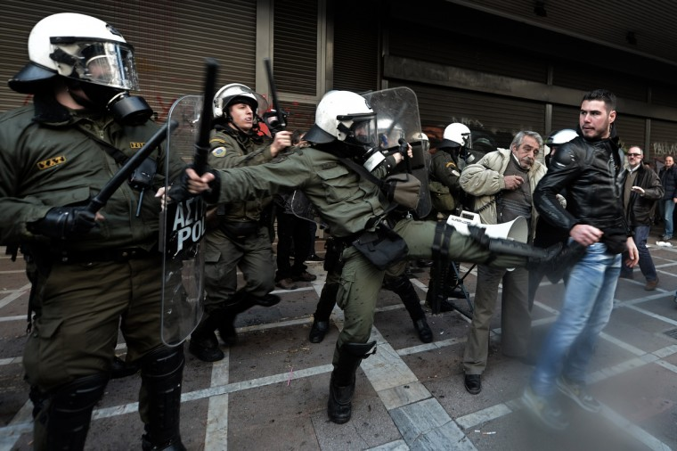 Protesters clash with riot police outside the Labour Ministry in Athens. Police were called in on Wednesday to dislodge around 30 Communist unionists from the labour ministry in a protest against new pension cut plans. The unionists were arrested and police used tear gas outside the building to disperse a larger group of protesters demanding their release. (Aris Messinis/Getty Images)