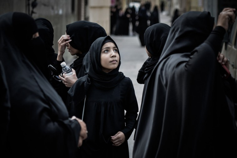 Bahraini Shiite Muslim women gather for a demonstration against the death of a child, in the village of Daih, west of Manama. The child, Qassim Habib Marzooq, died in hospital after developing respiratory complications and his relatives claim that his death is due to the inhalation of poisonous tear gas that riot police used during a protest in January 2013. (Mohammed Al-Shaikh/Getty Images)