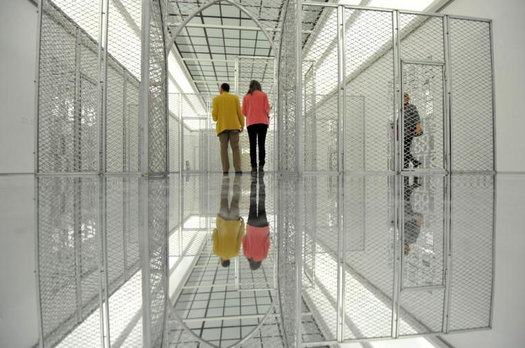 Journalists walk through the installation 'Mirrors, Razor mesh' (2008) of South African artist Kendell Geers during a press tour of the exhibition 'Kendell Geers 1988-2012' at the Haus der Kunst in Munich, southern Germany. (Andreas Gerbert/Getty Images)