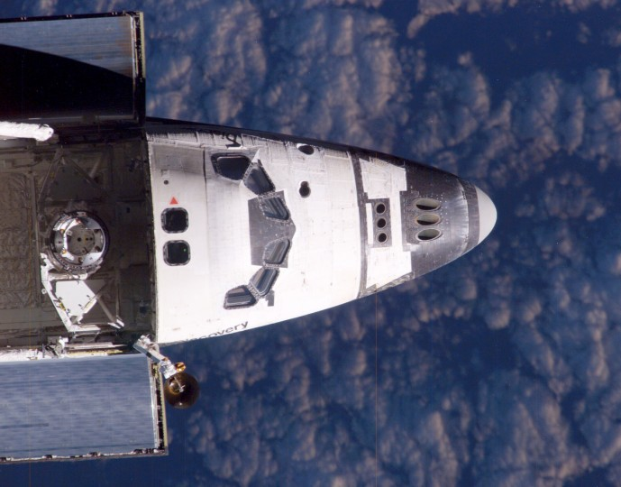 A view from the International Space Station shows the nose and forward cargo bay of the US space shuttle Discovery 28 July 2005 just before the shuttle docked with the station. (NASA photo/via Getty Images)