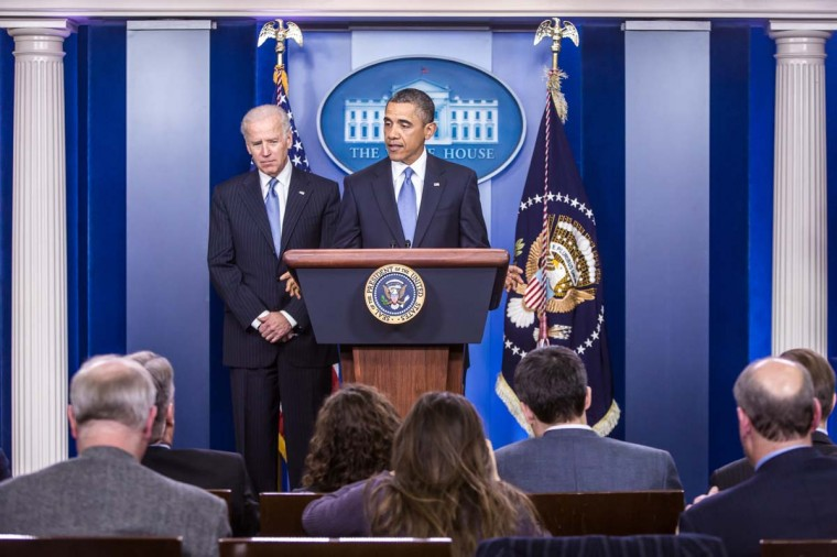 U.S. Vice President Joseph R. Biden (L) looks on as U.S. President Barack Obama makes a statement in the White House Briefing Room following passage by the House of Representatives of tax legislation on January 1, 2013. (Brendan Hoffman/Getty Images)