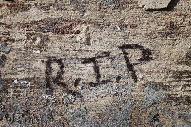 Rest In Peace is scrawled on a wall in the alley near the spot where 20-year-old Octavius Dontrell Lamb was shot yesterday and killed, on January 2, 2013 in Chicago, Illinois. Lamb was the first murder victim of 2013 in Chicago, a city which saw at least 506 murders in 2012. Fifteen people were shot in Chicago on the first day of the year, three fatally. (Scott Olson/Getty Images)