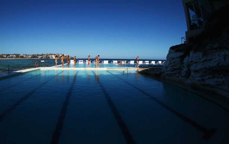 Players warm up before the Water Polo by the Sea match between Sydney University Lions and UNSW Wests at Bondi Icebergs, Bondi Beach in Sydney, Australia. (Ryan Pierse/Getty Images)