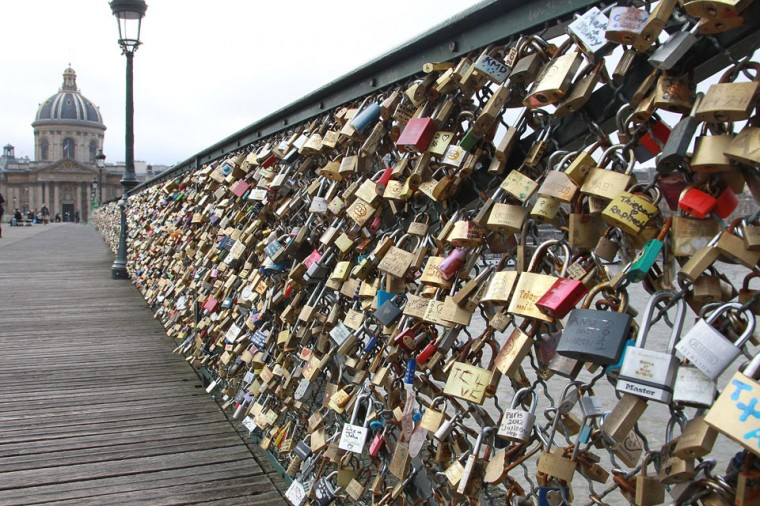 Padlocks adorn the Pont des Arts in Paris, France. The bridge is also a meeting place for artists who find inspiration from the surrounding views of the city. (Yves Forestier/Getty Images)