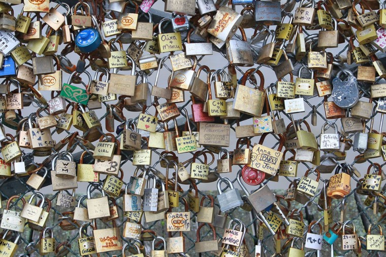 Padlocks adorn the Pont des Arts in Paris, France. The nine-arch metallic footbridge completed in 1804 is one of the most romantic places of the capital where people visit it to attach love padlocks illustrated with their initials or messages of love, before throwing the key into the River Seine. (Yves Forestier/Getty Images)