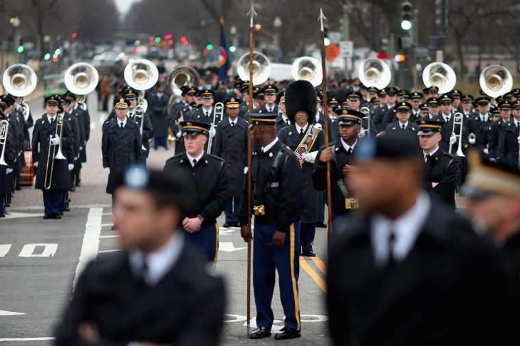 """Members of the U.S. Army Band, also called """"Pershing's Own,"""" stand ready along Pennsylvania Avenue during a dress rehersal for the Presidential Inaugural parade January 13, 2013 in Washington, DC. President Barack Obama and Vice President Joe Biden will be ceremonially sworn in for a second four-year term during the 57th Inauguration on January 21. (Chip Somodevilla/Getty Images)"""