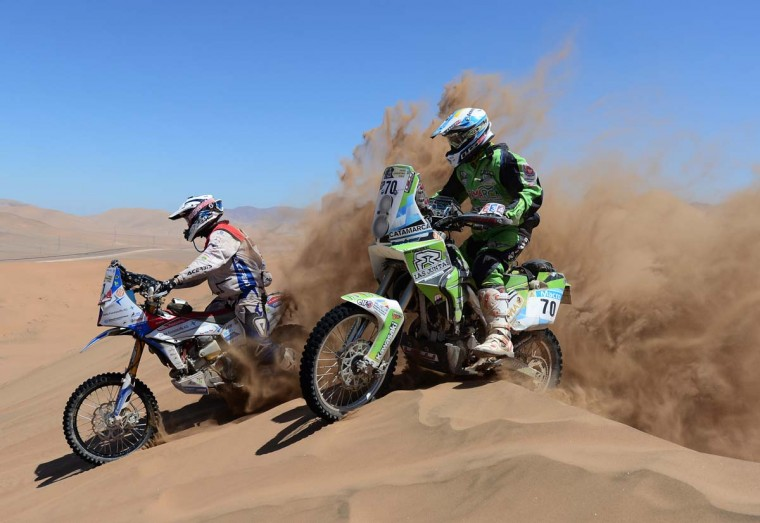 Diego Demelchori of team RPM Kawasaki and Simon Pavey of team Delta Kunstaffe Husqvarna UK competes in stage 13 from Copiapo to La Serena during the 2013 Dakar Rally on January 18 in Copiapo, Argentina. (Shaun Botterill/Getty Images)