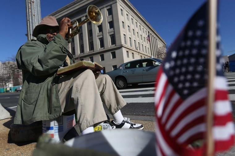 John Thornton plays a trumpet as Washington prepares for President Barack Obama's second inauguration on January 19, 2013 in Washington, DC. The U.S. capital is preparing for the second inauguration of U.S. President Barack Obama, which will take place on January 21. (Mario Tama/Getty Images)