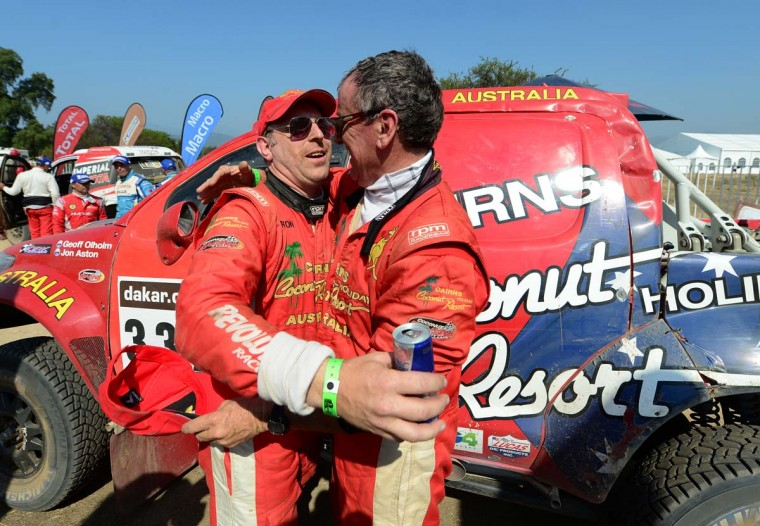 Geoff Olholm and co-driver Jonathan Aston of Australia embrace at the end of the 2013 Dakar Rally on January 19, 2013 in Limache, Chile. (Shaun Botterill/Getty Images)