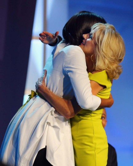 The First Lady Michelle Obama (L) is hugged by Jill Biden during the children's concert at the Washington Convention Center to celebrate military families on January 19, 2013 in Washington, DC. The U.S. capital is preparing for the second inauguration of U.S. President Barack Obama, which will take place on January 21. (Joe Raedle/Getty Images)