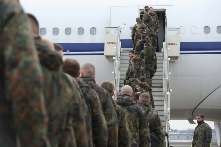 A contingent of approximately 240 soldiers of the German Bundeswehr board a plane for Turkey on January 20, 2013 in Berlin, Germany. German is committing two units of Patriot anti-missile systems to help defend Turkey from possible attack from Syria. (Sean Gallup/Getty Images)