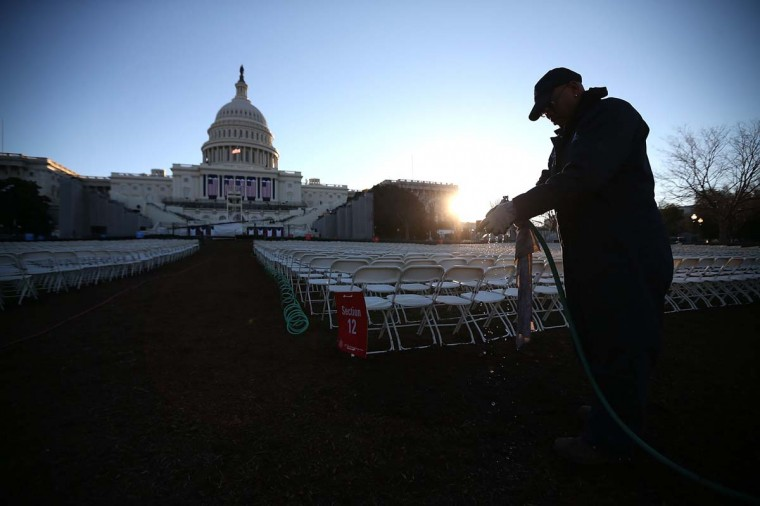 A worker prepares to wipe down chairs, set up in front of the U.S. Capitol Building on January 20, 2013 in Washington, DC. Washington is preparing for the second inauguration of U.S. President Barack Obama, which will take place on January 21. (Mark Wilson/Getty Images)