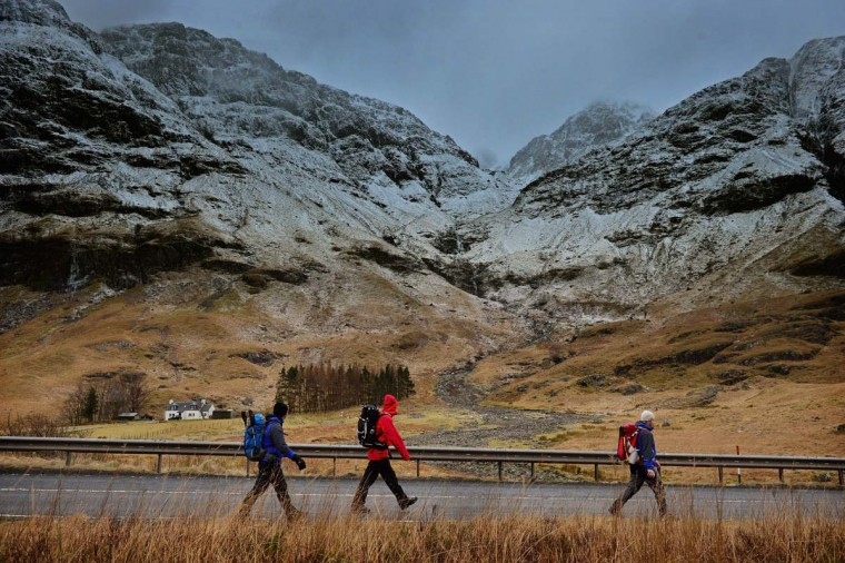 Climbers walk along the A82 next to Bidean Nam Bian on January 20,2012 in Glencoe, Scotland. Four climbers were killed yesterday following an avalanche on Bidean Nam Bian in Glencoe. A party of six, three men and three women were descending close to Church Door Buttress when the snow slope broke away. (Jeff J Mitchell/Getty Images)