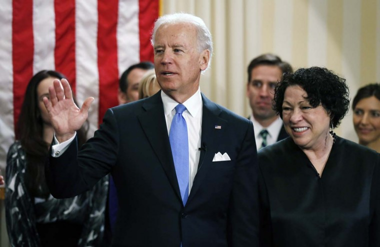 U.S. Vice President Joe Biden (L) stands with U.S. Supreme Court Justice Sonia Sotomayor after taking the oath of office during the official swearing-in ceremony at the Naval Observatory on January 20, 2013 in Washington, DC. Biden and U.S. President Barack Obama will be officially sworn in a day before the ceremonial inaugural swearing-in. (Kevin Lamarque-Pool/Getty Images)
