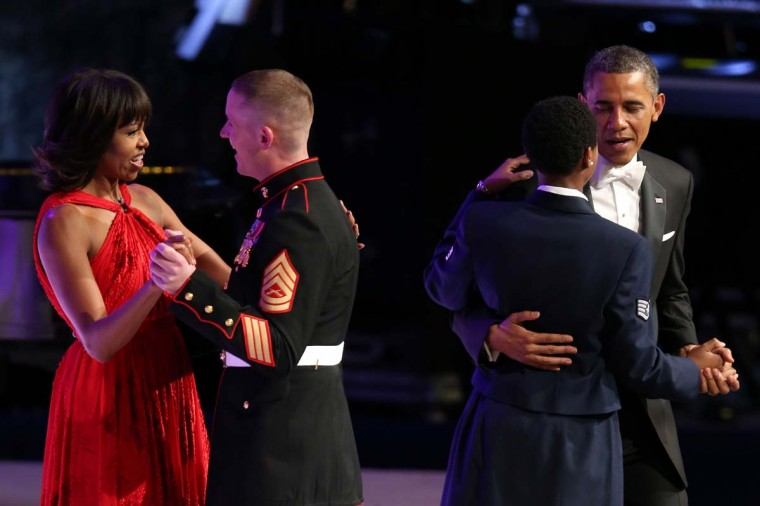 U.S. President Barack Obama (R) and first lady Michelle Obama dance with members of the military during the Commander in Chief Inaugural Ball at the Walter E. Washington Convention Center on January 21, 2013 in Washington, DC. (Chip Somodevilla/Getty Images)