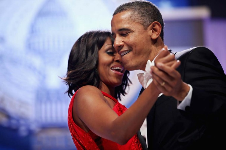 U.S. President Barack Obama and first lady Michelle Obama sing together as they dance during the Inaugural Ball at the Walter Washington Convention Center January 21, 2013 in Washington, DC. (Chip Somodevilla/Getty Images)
