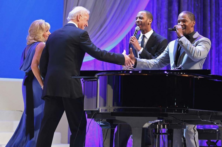 U.S. Vice President Joe Biden (2nd L) and Dr. Jill Biden (L) shake hands with actor and musician Jamie Foxx (R) after he sang while they danced at the Comander-in-Chief's Inaugural Ball at the Walter Washington Convention Center January 21, 2013 in Washington, DC. (Chip Somodevilla/Getty Images)