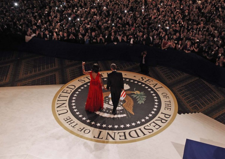 President Barack Obama and first lady Michelle Obama walk on stage for their first dance together at the Commander-in-Chief's Inaugural Ball at the Washington Convention Center January 21, 2013 in Washington, DC. (Pablo Martinez Monsivais-Pool/Getty Images)