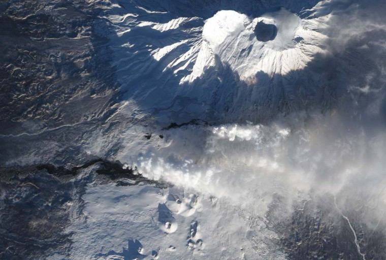 After more than a month of eruption, lava continues to flow from Tolbachik, one of many active volcanoes on Russia'€™s Kamchatka Peninsula as seen in this NASA image released on January 2, 2013. Response Team (KVERT) the eruption continued through December 30, 2012. (NASA Earth Observatory/HO via AFP/Getty Images)