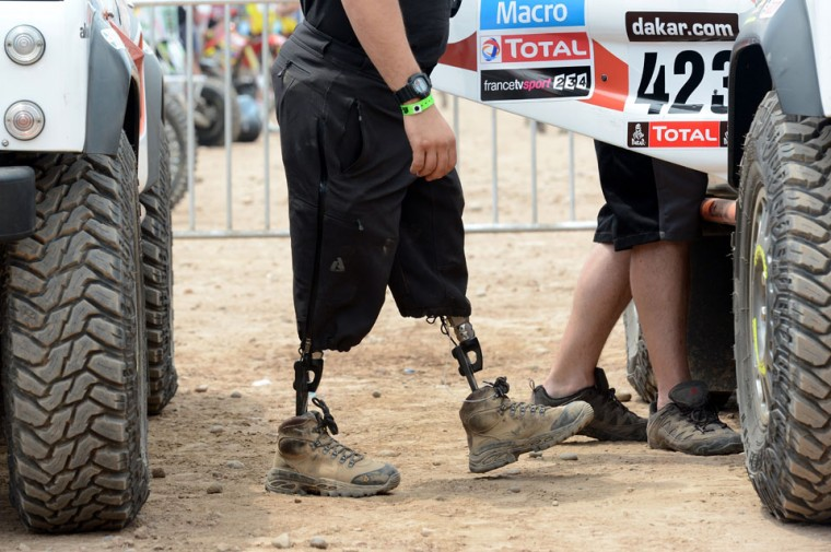 US Marine Corps former minesweeper Mark Zambon, member of the team Race 2 Recovery, consisting of British and US soldiers who have suffered serious injuries in the conflicts in Iraq and Afghanistan in recent years, enters a car in Lima on January 3, 2013, ahead of the 2013 Dakar Rally, which this year will thunder through Peru, Argentina and Chile from January 5 to 20. (Frank Fife/AFP/Getty Images)