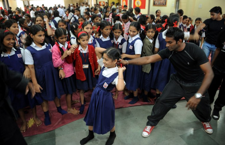An Indian instructor (2R) shows a self defence technique to a school girl during a self-defence classes at a school in Mumbai. (Punit Paranjpe/AFP/Getty Images)