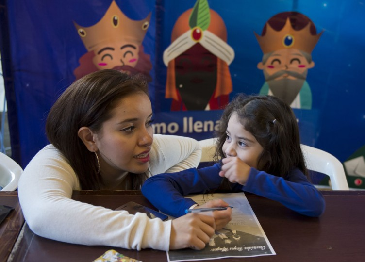 Valentina Talavera, right, listens to her godmother Maria Fernanda Garrido as she writes a letter to the Three Kings at the main post office in Mexico City on January 4, 2013. In Spanish-speaking parts of the world, children believe that the Three Kings receive their letters and so bring them gifts on the night before Epiphany. The Mexican Post Office opened this service to encourage the use of traditional mail. (Omar Torres/AFP/Getty Images)