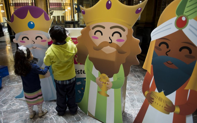 Children post letters to the Three Kings at the main post office in Mexico City on January 4, 2013. In Spanish-speaking parts of the world, children believe that the Three Kings receive their letters and so bring them gifts on the night before Epiphany. The Mexican Post Office opened this service to encourage the use of traditional mail. (Omar Torres/AFP/Getty Images)